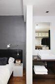 Grey wall and ensuite bathroom in bedroom