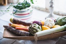 Winter vegetables in wooden bowl