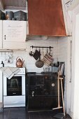Old kitchen cooker with copper extractor hood