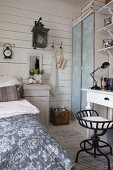 Wooden wall and desk in shabby-chic bedroom