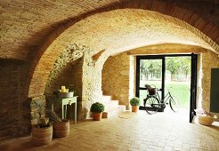 Bicycle in vaulted brick foyer