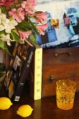 Books, flowers, lemons, drinking glass and wooden box