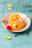 Edible yellow rose petals on plate