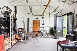 Swing hung from beam structure in workshop with retro ambiance
