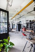 Swing hung from white beam structure in retro workshop