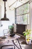 Vintage workbench and industrial windows in workshop