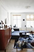 Ride-on car and vintage furniture in living room in shades of grey and brown