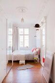 Bright bedroom with stucco ceiling in period apartment