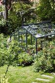 Greenhouse in summery garden