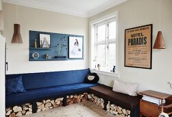 Upholstered corner bench with firewood stored below in living room