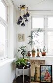 Retro lamp above houseplants on serving trolley