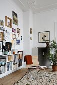 Reading corner and gallery of pictures in period apartment with stucco ceiling