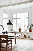 Bay window and rustic wooden floor in minimalist dining area