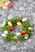 Small nest of cress and colourful sugar eggs
