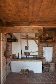 Traditional kitchen area in historical farmhouse