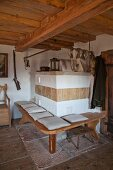 Tiled stove with bench in historical farmhouse
