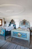 Traditional wooden twin beds in historical farmhouse