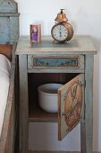 Chamber pot in traditionally painted bedside cabinet