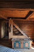 Old painted wooden trunk in historical farmhouse