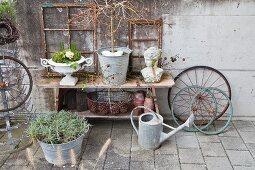 Rustic arrangmetnt of upcycled materials in garden
