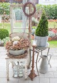 Rustic arrangment of vintage accessories in garden