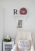 Vintage-style seating corner with vintage printed scatter cushion