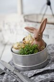 Cress, small snacks and chocolate Easter bunny in tin