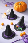 Black witches' hats decorating table for Halloween party