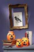 Halloween pumpkin lanterns made from old jam jars