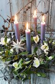 Advent wreath of mistletoe, sloes and hellebores