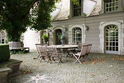 Seating area on cobbled courtyard adjoining classic building