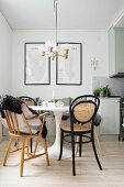 White Tulip Table, black bentwood chairs and retro lamp in dining area