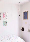 Girls room with dotted bedding, light bulb pendant lamp and wall decoration