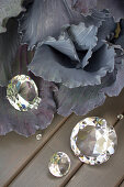 Silvery-grey red cabbage and glass prisms reflecting autumn colours
