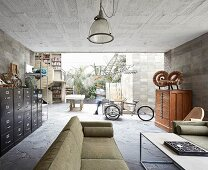 Vintage furniture in open-plan interior of concrete house