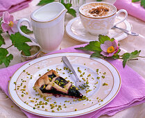 Anemone hupehensis, blackberry cake with chopped pistachios