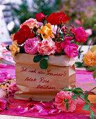 Bunch of roses in paper bag