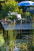 Wooden deck in the swimming pond