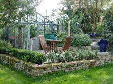 Art garden, terrace at the greenhouse