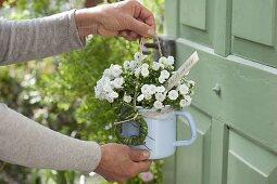 Blooming bellflower in enameled milk pot as a welcome greeting
