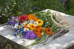 Woman tying colorful summer bouquet