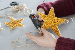 Homemade Christmas tree decorations made of corn and beans