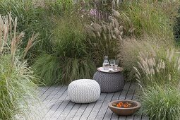 Wooden terrace with grassy bed as a screen
