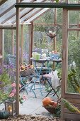 Small terrace in the greenhouse, table and chairs
