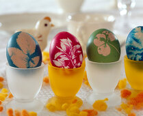 Colored easter eggs with leaf impression