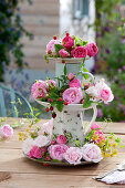 Homemade cake stand with rose petals