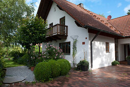 Rural property with paved driveway, Buxus