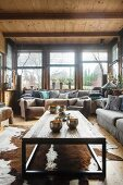 Animal-skin rug and view of garden from lounge in cosy dacha