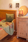 Festive decorations in rustic bedroom with wooden elements