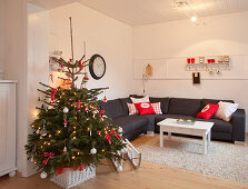 Decorated Christmas tree in modern apartment